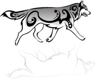 Running wolf with patterns. Vector drawing of a wolf running with patterns Royalty Free Stock Image
