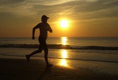 Running woman. A woman runs into the sunset Royalty Free Stock Photography