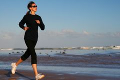 Running woman Stock Images