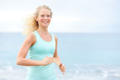 Running woman athlete jogging outside on beach Royalty Free Stock Photography