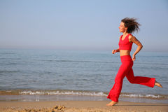 Running woman on beach Stock Photo