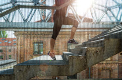 Running woman in black sports outfit, running up the stairs Royalty Free Stock Image
