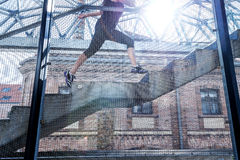 Running woman in black sports outfit, running up the stairs ,detail photo.  Royalty Free Stock Photos