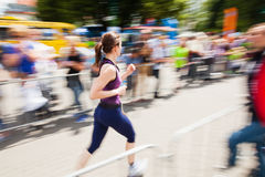 Running woman at Bonn Triathlon Stock Images