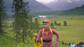 Running woman in cross country trail run. stock video