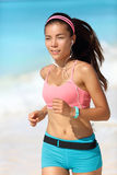 Running woman with earphones and fitness watch Stock Image