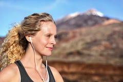 Running woman with earphones - runner portrait Stock Images