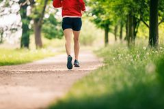 Running woman, enjoying summer day in park Stock Photos