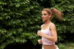 Running woman. Female runner jogging during outdoor Royalty Free Stock Photos