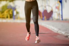 Running woman. Female runner jogging during outdoor on road .Yo royalty free stock image