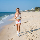 Running woman. Female runner jogging during outdoor workout on b Stock Image