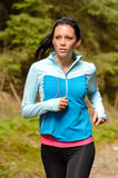 Running woman with headphones outdoor royalty free stock images