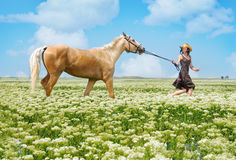 Running woman and horse Royalty Free Stock Photography