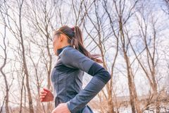 Free Running Woman In Autumn Forest Outdoors In Morning Fresh Air Doing Cardio Workout Exercise Living A Healthy Lifestyle. Girl Runner Royalty Free Stock Photography - 156361857