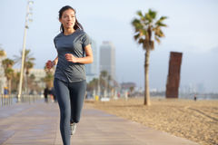 Running woman jogging Barcelona Beach Barceloneta. Running woman jogging on Barcelona Beach, Barceloneta. Healthy lifestyle girl runner training outside on Stock Images