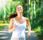 Running Woman Jogging. Running woman. Female Runner Jogging in a Park royalty free stock images