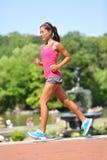 Running woman jogging New York City Central Park. Running woman jogging in New York City, Central Park, Manhattan. Sport runner girl training. Female fitness Stock Image