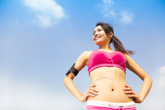 Running woman jogging outdoors listening to music Royalty Free Stock Photos
