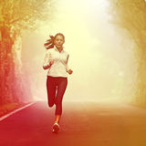 Running woman jogging on road Royalty Free Stock Photography