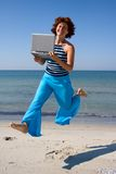 Running woman with laptop Royalty Free Stock Photo
