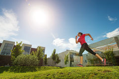 Running woman. outdoors, behind buildings Stock Photos