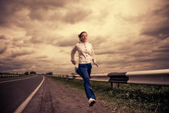 Running woman outside Royalty Free Stock Photo