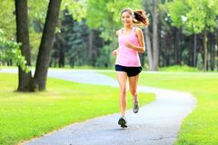 Running woman in park Stock Image