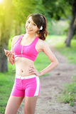 Running woman in park. Asian sport fitness model in sporty running clothes Stock Photography