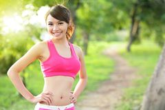 Running woman in park royalty free stock image