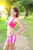 Running woman in park. Asian sport fitness model in sporty running clothes Royalty Free Stock Image
