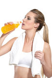 Running woman refreshing with a drink Stock Photos