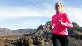 Running woman runner exercising stock video footage