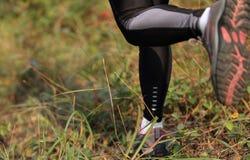 Running woman runner feet Royalty Free Stock Photo