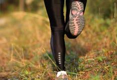 Running woman runner feet Stock Images