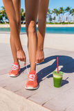 Running woman runner with green vegetable smoothie Royalty Free Stock Photos