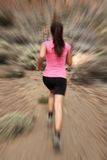 Running - woman runner in motion stock image