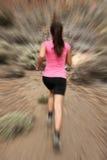 Running - woman runner in motion. Zoom blur for speed effect. Female running outside in desert Stock Image