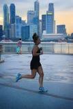 Running woman, Singapore Royalty Free Stock Photo