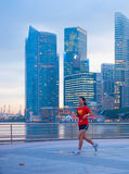 Running woman, Singapore Royalty Free Stock Images