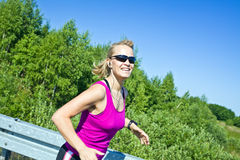 Running woman in summer nature Royalty Free Stock Photo