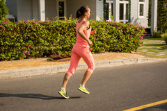 Running woman in summer training. Sport fitness model in sporty Royalty Free Stock Images