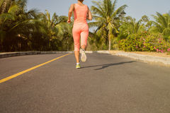 Running woman in summer training. Sport fitness model in sporty Stock Photography