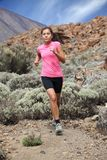 Running - Woman trail runner Royalty Free Stock Photos