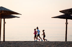 Running women. On a beach at sunset Stock Photo