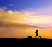 Running women and dog Royalty Free Stock Images