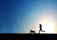 Running women and dog Stock Photo