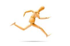 Running wooden figure Stock Image