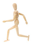 Running Wooden Mannequin. Wooden mannequin running isolated on white background Stock Image