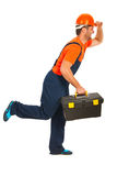 Running workman. Holding tool box isolated on white background Royalty Free Stock Photography