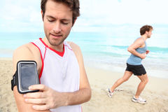 Running workout with music Royalty Free Stock Images